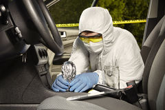 Collecting of odor traces by criminologist from gear shift Royalty Free Stock Image