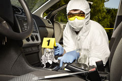 Collecting of odor traces by criminologist from gear shift Royalty Free Stock Photo