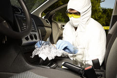 Collecting of odor traces by criminologist from gear shift Stock Photography