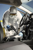 Collecting of odor traces by criminologist from pistol in car Royalty Free Stock Images