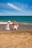 Collecting seashells Royalty Free Stock Image
