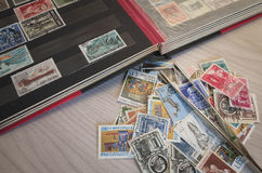 Collecting stamps. Stamp collection with some tools Royalty Free Illustration
