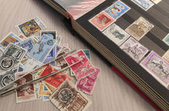Collecting stamps. Stamp collection with some tools Royalty Free Stock Photography