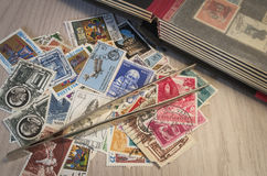 Collecting stamps. Stamp collection with some tools Stock Photos