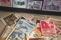 Collecting stamps. Stamp collection with some tools Stock Photography