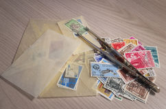 Collecting stamps. Stamp collection with some tools Stock Images