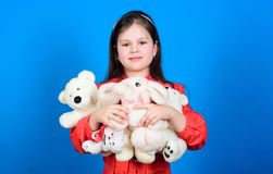Collecting toys hobby. Cherishing memories of childhood. Childhood concept. Small girl smiling face with toys. Happy. Childhood. Little girl play with soft toy royalty free stock photos