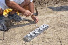 Collecting underground samples from drilled special prepared assessment point Stock Photo