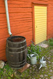 Collecting water at the back of the garden. Sweden Stock Photography