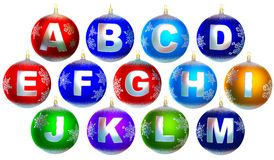 Collection of 13 shiny chrismas baubles. With letters from a to m Royalty Free Stock Images