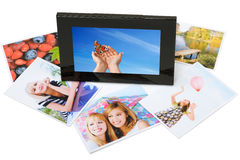Collection. Digital frame with printed photos stock image