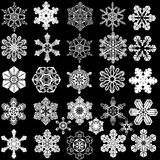 Collection of 28 symmetrical snowflakes. Stock Photography