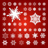 Collection of 50 Fifty Snowflakes on Red. Collection of 50 Fifty White 3D Effect Vector Snowflakes on Red Royalty Free Illustration