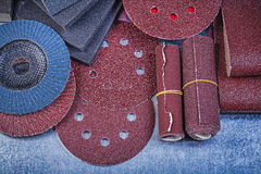 Collection of abrasive materials on metallic background close up. View Royalty Free Stock Image
