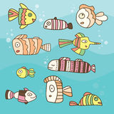 Collection of abstract fish on blue background. Hand drawn fantastic set Royalty Free Stock Photo
