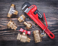 Collection of adjustable pipe wrench brass fittings water valve Royalty Free Stock Photos