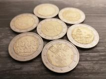Set of Lithuanian 2 Euro coins on the wooden background royalty free stock image