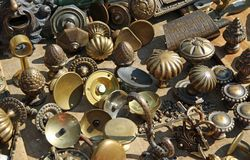 Collection of ancient bronze handles at flea market Stock Image