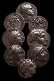 Collection of ancient greek coins on a black background Stock Photo