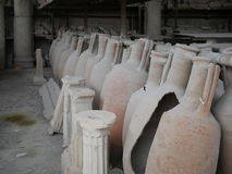 Collection of antique earthenware amphoras. A uniquely pointed container used by ancient Greeks and Romans to store and transport mainly wine and oil but also royalty free stock image