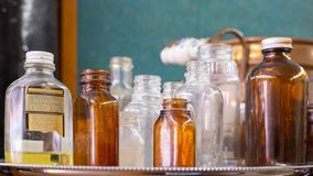 A collection of antique glass bottles one of which has castor oil with the label claiming that it is tasteless. A collection of antique glass bottles on a Stock Image