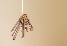 Collection of Antique Keys Dangling from String Stock Images