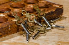 Antique Pocket Watch Keys Scattered on the Watchmaker's Bench. Collection of Antique Pocket Watch Keys Scattered on the Watchmaker's Bench royalty free stock image