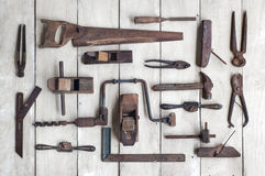 Collection of antique woodworking tools on wooden table Royalty Free Stock Photos