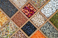 Collection assorted of lentils, beans, peas, grain, groats, soyb. Eans, legumes in wooden box Stock Photography