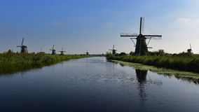 A collection of authentic historic windmills in Kinderdijk, Netherlands Royalty Free Stock Photography