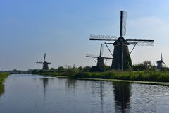 A collection of authentic historic windmills in Kinderdijk, a UNESCO World Heritage site Stock Images