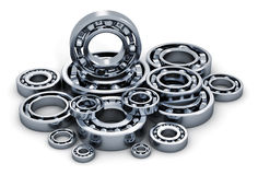 Collection of ball bearings. Creative abstract industry, manufacturing and engineering concept: collection of different steel shiny ball bearings isolated on Stock Image