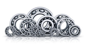 Collection of ball bearings. Collection of different steel shiny ball bearings isolated on white background with reflection effect Stock Images