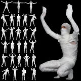 Collection of bandaged mummies isolated on black Stock Photo