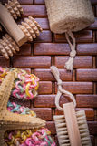 Collection of bath accessories on checked wooden table mat healt Stock Images