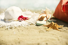 Collection of beach items. Seastar, flip-flops, sunglasses and hat Stock Photo
