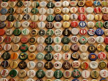 A collection of beer caps Stock Photo