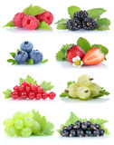 Collection of berries fruits grapes strawberries blueberries red Stock Image
