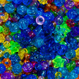 A collection of  big, bright and colorful children`s beads. Close up of some fun and inspiring children`s beads Stock Photo