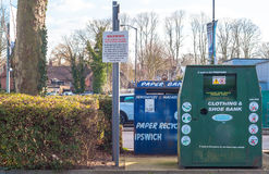 A collection bin for second hand clothes and shoes in a carpark Stock Photo