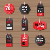 Collection Of Black Friday Tags On Wooden Textured Background Shopping Icons  Stock Photo