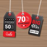 Collection Of Black Friday Tags On Wooden Textured Background Shopping Icons  Stock Photos