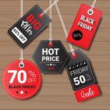 Collection Of Black Friday Tags On Wooden Textured Background Shopping Icons And Logos Set Design Royalty Free Stock Images