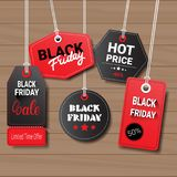 Collection Of Black Friday Tags On Wooden Textured Background Shopping Icons And Logos Set Design Royalty Free Stock Photography