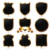 Collection of black and golden shields Stock Photography