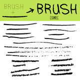 A collection of black grungy isolated abstract hand-painted brush strokes banner to create your textures. Vector Royalty Free Stock Images