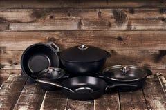 Collection of black pots Stock Photos