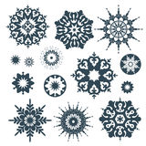 Collection of black snowflakes on a white background Royalty Free Stock Image