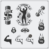 Collection of black and white fitness labels, emblems, badges, logos and design elements. Silhouette of bodybuilder and arm muscle Royalty Free Stock Photo