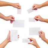 Collection of blank cards in a hand. Isolated on white Royalty Free Stock Photos